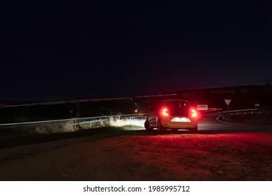 Avila, Spain; 03.25.2021: Car parked near a  double-lane national road