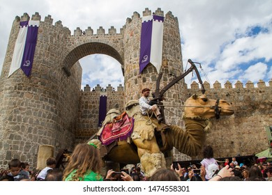 Avila, Spain - 09 08 2018: Medieval Festival, an annual event in Avila. Robotic camel passing by the streets of the old town.