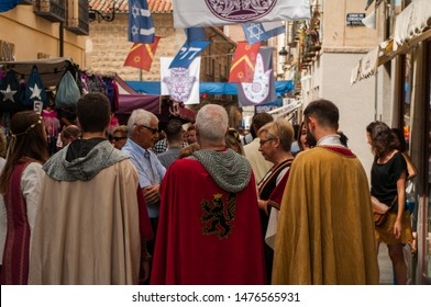 Avila, Spain - 09 08 2018: Medieval Festival, an annual event in Avila. Three medieval knights in a Jewish District.