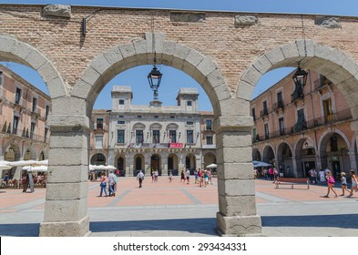 AVILA, SPAIN - JUNE 27: Tourist are walking in Mercado Chico square in the city of Avila during the 5th centenary of Santa Teresa, on June 27, 2015. Town Hall is placed in Plaza del mercado chico