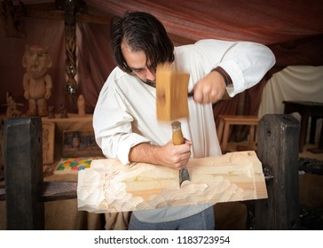 Avila, Spain, September 7, 2018, artisan of wood working the pine at the medieval fair celebrated in this Spanish city