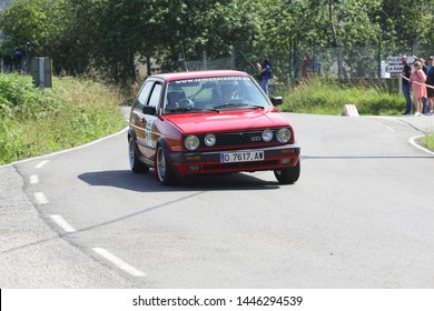 """AVILES, SPAIN - JULY 6 2019: Triviño drives a Volkswagen Golf GTI car during   """"34 Historic Rally of Aviles""""  on July 6, 2019 in Aviles, Spain"""