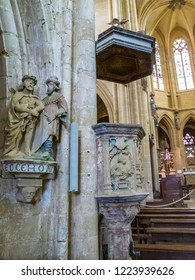 AVIOTH, FRANCE - SEPTEMBER 14, 2014: Interior of the Basilica of Our Lady, Basilique Notre-Dame - a 14th-century sculpture group Ecce Homo and a Renaissance stone pulpit from 1538