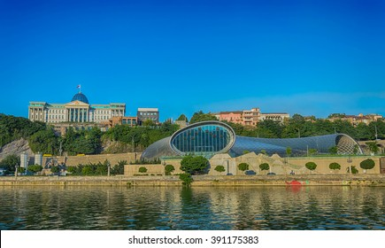 Avlabar residence of the President of Georgia  and new concert hall in Tbilisi.  View from  Kura River. July 2015. Georgia.