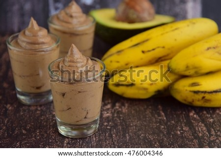 Avocado Banana Chocolate Pudding on Wooden Background