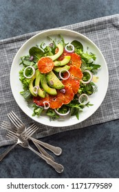 Avocado and Blood Orange Salad with Fennel Over Mixed Greens on a Plate