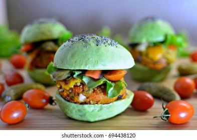 Avocado burger with red kari quash pattie
