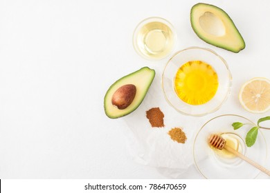 Avocado in cooking and preparing homemade cosmetics. Copy space text