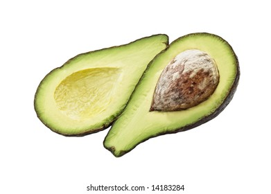 An avocado cut in two pieces, white background.