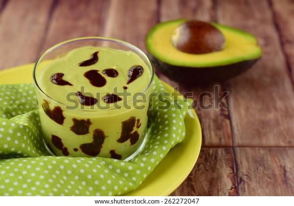 Avocado dessert pudding with chocolate sauce