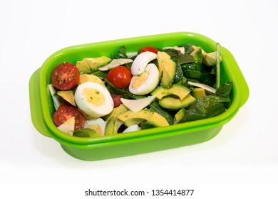 avocado, egg, cherry tomates, greens in the lunch box