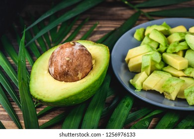 Avocado exotic fruits from tropical countries on table. Green  flesh. Healthy food with vitamin