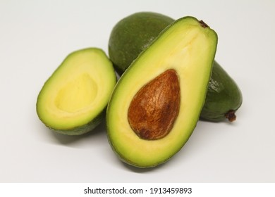 Avocado fresh green half on white.
