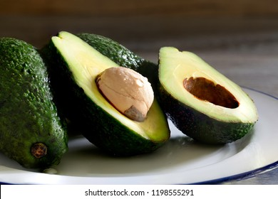 Avocado fruit for healthy body  in white dish  / Select focus and still life image, space for texts