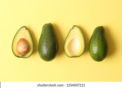 Avocado fruit on a colored background top view.