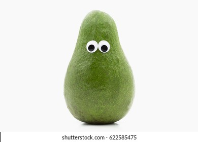 avocado with googly eyes on white background