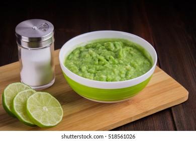 avocado Guacamole on molcajete real Mexican traditional procedure.