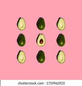 Avocado isolated on pink background. Fresh. Vegetables. Food photo.