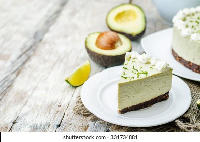 avocado lime cheesecake on a white wood background. toning. selective focus