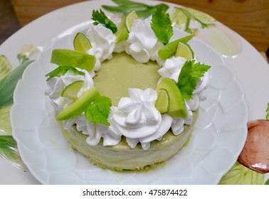 avocado lime cheesecake on a white wood background. toning. selective focus, vegan dessert low calories healthy food concept