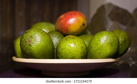 avocado and mango on a wooden plate
