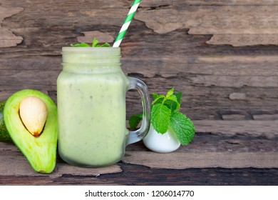 avocado mix banana smoothies green colorful fruit juice milkshake blend beverage healthy high protein the taste yummy In glass,drink episode morning on a wooden background.