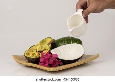 Avocado mix coconut milk for hair. (Dry hair treatment).