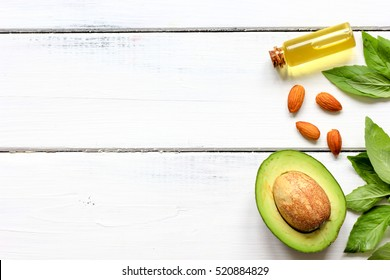 avocado oil for handmade cosmetics on wooden background
