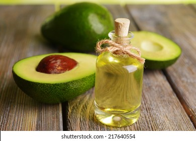 Avocado oil on table close-up