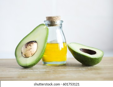 Avocado and oil on a white background
