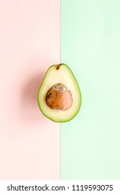 Avocado on colorful background. Food concept. flat lay, top view