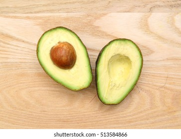 Avocado on a dark wood background. tinting. selective focus