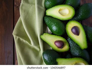 avocado on dark wooden surface