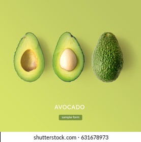 Avocado on the green background. Top view