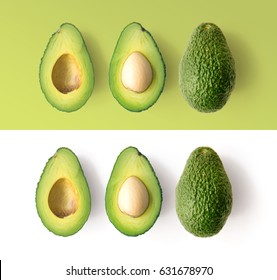 Avocado on the green and white background. Top view