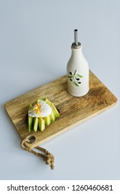 avocado on tost with egg, smorebrod, wooden cutting Board