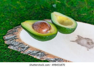avocado on wooden frame on the grass