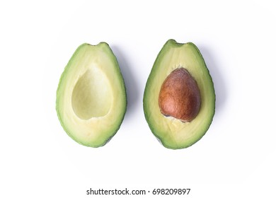 Avocado plus half seed isolated on white background.