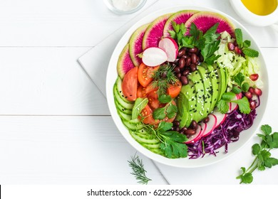Avocado, red bean, tomato, cucumber, red cabbage  and watermelon radish  vegetables salad. healthy raw vegan lunch bowl. Top view