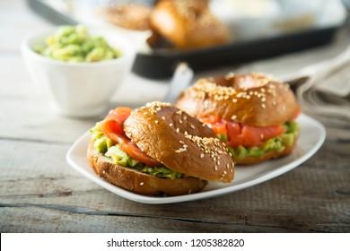 Avocado salmon sandwich on bagel