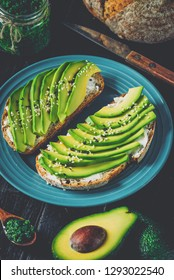 Avocado sandwich on dark rye bread made with fresh sliced avocados from above.