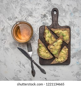 avocado sandwiches and tea, healthy breakfast concept on white background