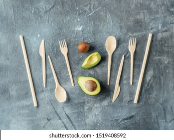 Avocado Seeds Biodegradable Single-Use Cutlery. Bioplastic - Great alternative to plastic disposable cutlery. Top view, flat lay. Gray background