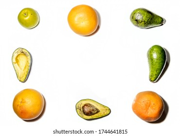 avocado slices, Apple and oranges are laid out on a white background
