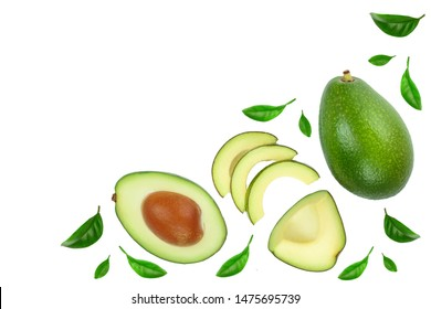 avocado and slices decorated with green leaves isolated on white background with copy space for your text. Top view. Flat lay