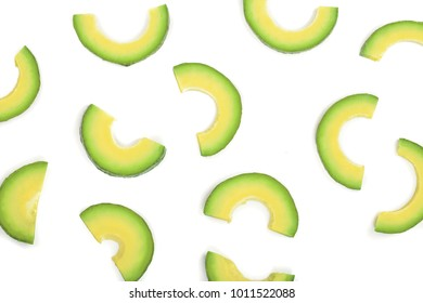 avocado slices isolated on white background. Top view. Flat lay pattern