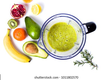 Avocado smoothie in a blender with various ingredients top view