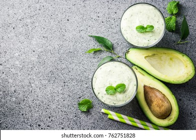 Avocado spinach peanut butter smoothie. Top view, copy space.