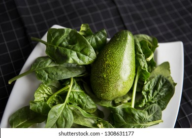 Avocado and spinach salat. Diet, weight loss, healthy eating concept