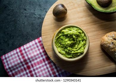 Avocado spread. Sliced avocado. Place to text.